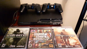 playstation 3 with 7 games and two controllers