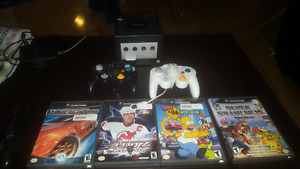Gamecube with 2 controllers and 4 games and a memory card.