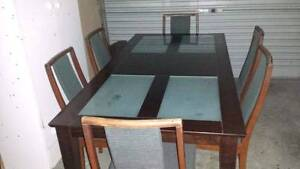 Glass and wooden dining table and 6 chairs St Albans Brimbank Area Preview