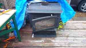 Certified wood stove and stainless chimney one year old $800!!