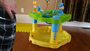 Adjustable exersaucer