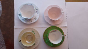 4 COLLECTIBLE  CUP AND SAUCERS