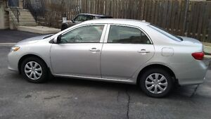 2010 Toyota Corolla White Sedan