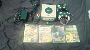Gamecube with two controllers and four games