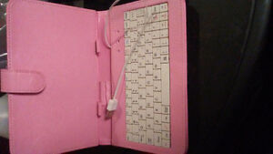 Pink plug in keyborad in folding carrying case for tablet