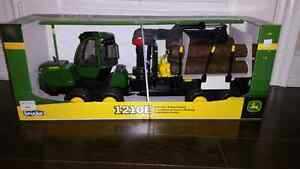 Brand new in box Bruder John Deere 1210E Forwarder