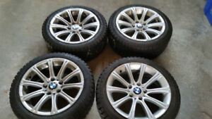 4 Used 17 BMW 3 series wheels with 225/45/17 Champiro Snow Tires