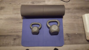 Two kettle bells and a free yoga mat.