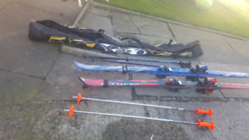 2 sets of skis poles and canvas bag