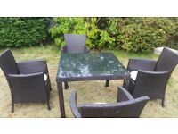 Black rattan garden table and chairs