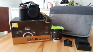 Nikon D3400 with warranty and all accessories.