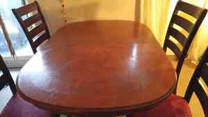 Dual pedestal dining room table