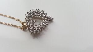 2 carat diamond heart pendant on a 14k yellow gold necklace