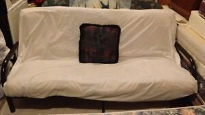 Almost new futon. Very comfortable. Clean with no damage.