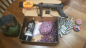 Paintball gun with supplies