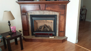 Propane fireplace and custom mantel