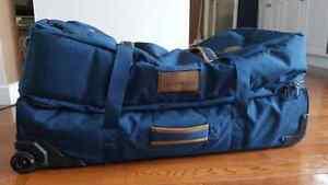 Blue Dakine Suitcase