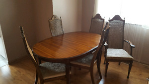 Brown dinning table with 6 chairs