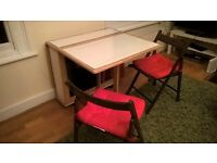 Fold out table with 5 chairs to sell
