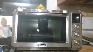 BRAND NEW never used delonghi toaster oven London Ontario image 3