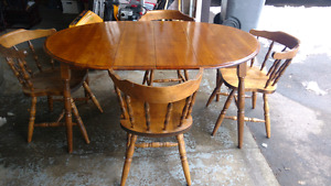 Solid wood (maple) dining room table and 4 chairs