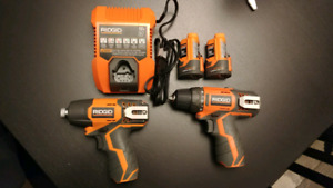 Brand New 12 volt compact drill and impact w/ 2 battery$100 OBO