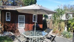 Large patio table with swivel chairs