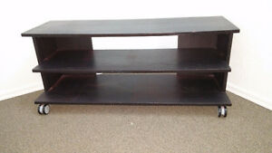 VEY NICE,LIKE NEW BLACK WOODEN COFFEE TABLE ON CASTERS