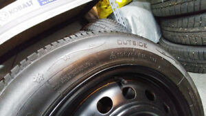 Winter tires on steel rims.