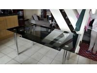Black glass dinning table and 6 chairs