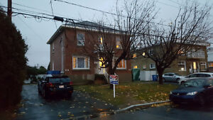 3 and 1/2 bright, semi-basement apartment for rent