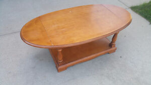 Antique solid wood coffee table with fold up extensions