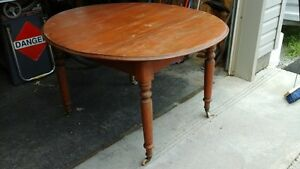 Antique kitchen table with wood wheels