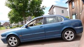 Jaguar x type full year mot