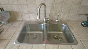 """32"""" stainless steel sink & Moen pull out faucet."""