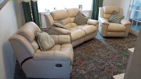 Reclining cream leather three piece suite
