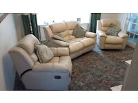 Reclining cream leather three piece suite