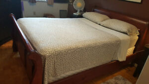 Queen size sleigh bed frame.