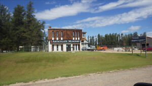 UNRESERVED REAL ESTATE AUCTION 3 ACRES WITH LARGE SHOPS