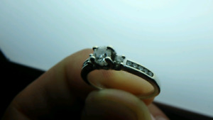 Peoples - 14 karat white gold ring,  .50 CT diamond