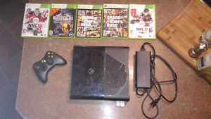 Xbox 360 e  4gb with games and remote