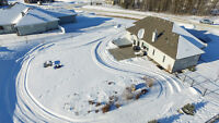 County Living near YEG! 1.13 acres, city water, workshop + more!