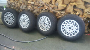 4 like new Mazda 626  winter tires and rims P185/70R/14