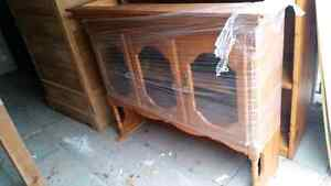 Solid wood cabinet with 3 glass doors.