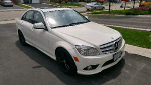 Very clean 2009 Mercedes-Benz c230 4 Matic low price low kms