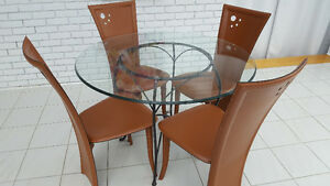 Glass table with iron legs, 4 leather chairs