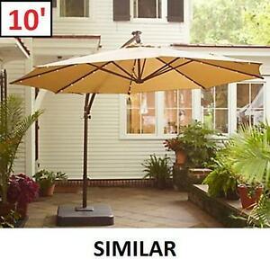 NEW OFFSET PATIO UMBRELLA W/ BASE - 124911469 - 10' W/ SOLAR LIGHTS BEIGE