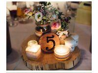 Wedding centrepieces tree logs & rustic jars