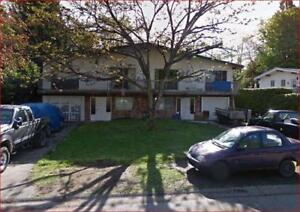 2 Legal Strata Up/Down 1/2 Duplexes - Brent Roberts Realty