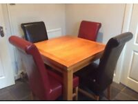 harveys extendable dining table and 4 leather chairs